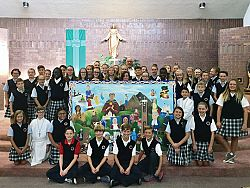 Students' painting of saints presented to parish
