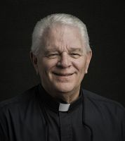 Fr. John J. Schwall presented with Christ the Teacher award