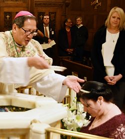 For newly baptized cathedral parishioner, year of conversion was filled with joys, sorrows